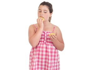 Early Periods May Heighten Obesity Risk Later