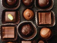 13-year study finds lower odds for atrial fibrillation in people eating moderate amounts of the treat.
